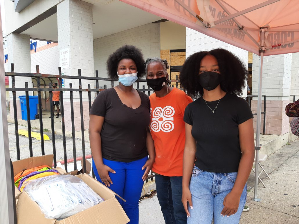 AGB Summer Business interns assist with summer backpack giveaway